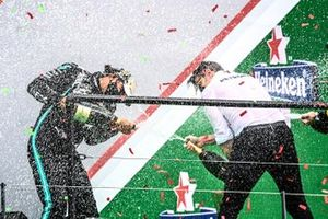 Lewis Hamilton, Mercedes-AMG F1, 1st position, and Peter Bonnington, Race Engineer, Mercedes AMG, celebrate with Champagne on the podium