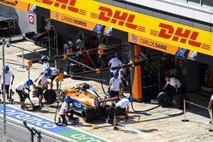 Lando Norris, McLaren MCL35, in the pit lane