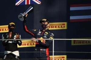 Alex Albon, Red Bull Racing, 3rd position, lifts his trophy on the podium