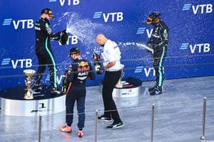 Max Verstappen, Red Bull Racing, 2nd position, Valtteri Bottas, Mercedes-AMG F1, 1st position, and Lewis Hamilton, Mercedes-AMG F1, 3rd position, celebrate on the podium