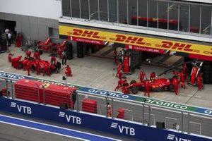 Sebastian Vettel, Ferrari SF1000, and Charles Leclerc, Ferrari SF1000, are returned to the garage
