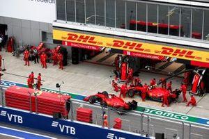 Sebastian Vettel, Ferrari SF1000, and Charles Leclerc, Ferrari SF1000, in the pit lane