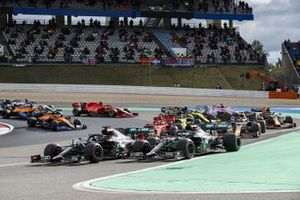Valtteri Bottas, Mercedes F1 W11, and Lewis Hamilton, Mercedes F1 W11, lead the field away at the start