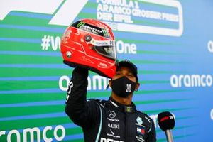 Lewis Hamilton, Mercedes-AMG F1, 1st position, with the helmet of Michael Schumacher that was presented to him by Mick Schumacher in Parc Ferme