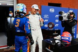 Daniel Ricciardo, McLaren, and George Russell, Williams, talk in Parc Ferme after Qualifying