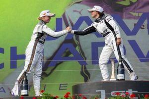 Alice Powell and Jamie Chadwick celebrate on the podium