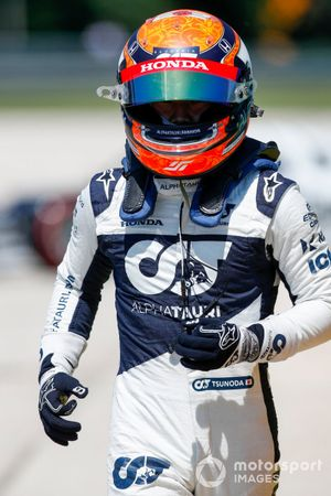 Yuki Tsunoda, AlphaTauri, walks away from his car after spinning out in practice