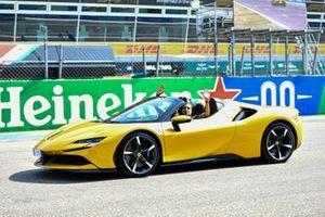Marc Gene drives a Ferrari on the grid