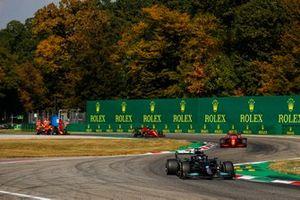 Lewis Hamilton, Mercedes W12, Charles Leclerc, Ferrari SF21, and Carlos Sainz Jr., Ferrari SF21