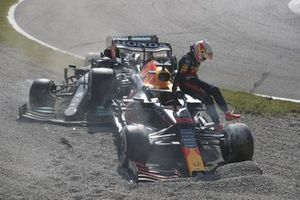 Max Verstappen, Red Bull Racing, jumps out of his car after crashing out with Lewis Hamilton, Mercedes W12