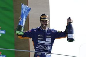 Daniel Ricciardo, McLaren, 1st position, with his trophy and Champagne on the podium