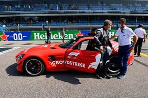 Bernd Maylander, Safety Car Driver, and the Safety Car on the grid with Michael Masi, Race Director, FIA