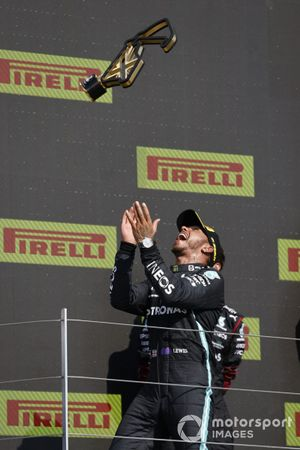 Lewis Hamilton, Mercedes, 1st position, celebrates on the podium by tossing his trophy in the air