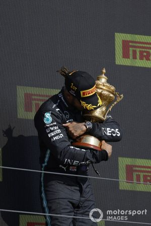 Lewis Hamilton, Mercedes, 1st position, on the podium with the original trophy