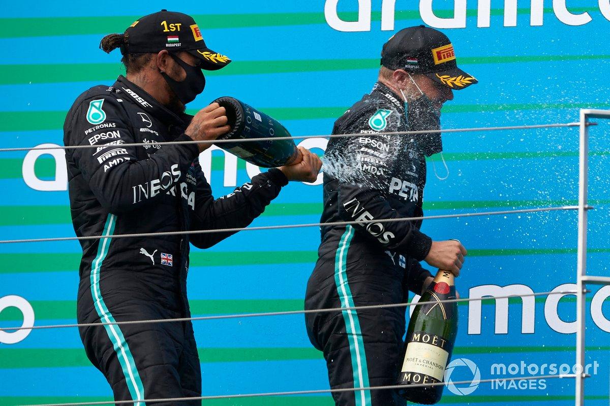Lewis Hamilton, Mercedes-AMG Petronas F1, and Valtteri Bottas, Mercedes-AMG Petronas F1 on the podium