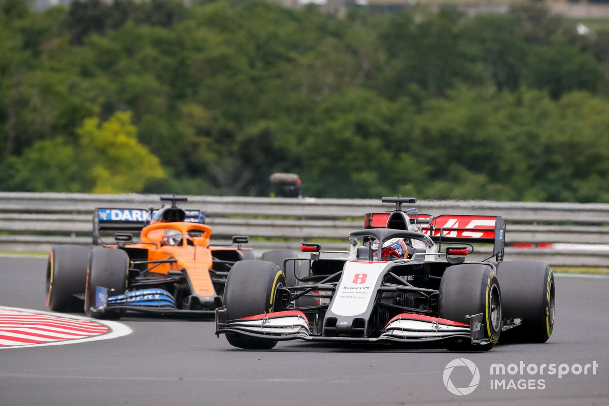 Romain Grosjean, Haas VF-20, leads Carlos Sainz Jr., McLaren MCL35