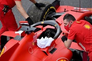 Mechanics with the car of Sebastian Vettel, Ferrari SF1000, after a breakdown due to a technical failure