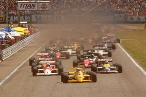 Ayrton Senna, Lotus 99T Honda, leads Alain Prost, McLaren MP4/3 TAG Porsche and Nigel Mansell, Williams FW11B Honda