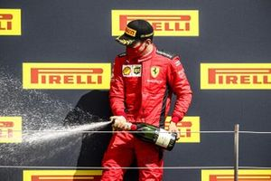 Charles Leclerc, Ferrari celebrates on the podium with the champagne