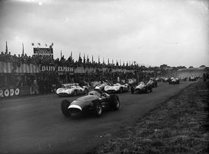 Stirling Moss, Maserati 250F, leads Juan Manuel Fangio, Mercedes W196, Jean Behra, Gordini T16, Karl Kling, Mercedes W196, and Mike Hawthorn, Ferrari 625 at the start