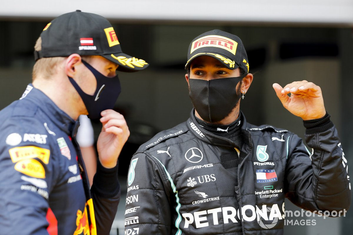 Max Verstappen, Red Bull Racing and Race Winner Lewis Hamilton, Mercedes-AMG Petronas F1 celebrate in Parc Ferme