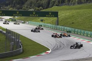 Lewis Hamilton, Mercedes F1 W11 EQ Performance, leads Max Verstappen, Red Bull Racing RB16, Carlos Sainz Jr., McLaren MCL35, Valtteri Bottas, Mercedes F1 W11 EQ Performance, Alex Albon, Red Bull Racing RB16, and the rest of the field at the start
