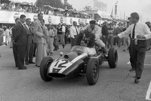 Jack Brabham gives John Cooper a lift on the back of his Cooper T51 Climax