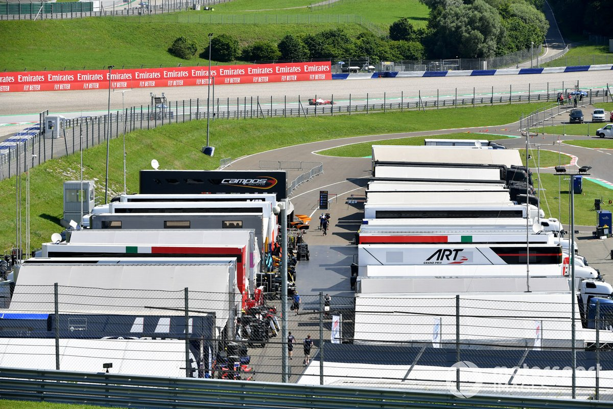 A view of the teams in the paddock