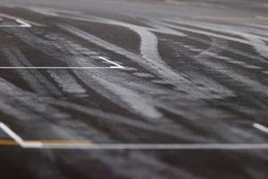 Pit straight grid detail, including rubber marks on the asphalt