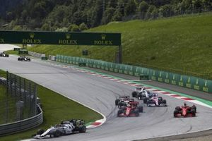 Pierre Gasly, AlphaTauri AT01, leads as Charles Leclerc, Ferrari SF1000, and Sebastian Vettel, Ferrari SF1000, collide on the opening lap