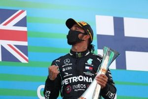 Lewis Hamilton, Mercedes-AMG Petronas F1, 1st position, celebrates on the podium with his trophy
