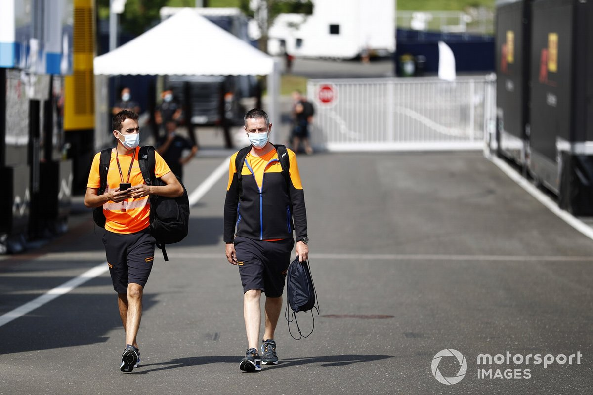 McLaren team members arrive in the paddock