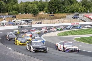 Denny Hamlin, Joe Gibbs Racing, FedEx Express Toyota Camry and Aric Almirola, Stewart-Haas Racing, Smithfield Hometown Original Ford Mustang lead the field to the start