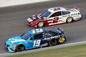 Martin Truex Jr., Joe Gibbs Racing, Toyota Camry. Brad Keselowski, Team Penske, Ford Mustang