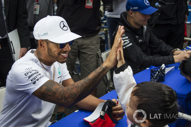 Lewis Hamilton, Mercedes AMG F1, high fives a young fan