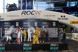 The drivers celebrate on the podium