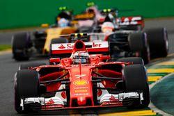 Kimi Raikkonen, Ferrari SF70H, leads Kevin Magnussen, Haas F1 Team VF-17