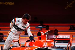 Fernando Alonso, McLaren, inspects the cockpit of the MCL32