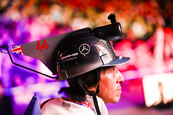A fan with a Lewis Hamilton, Mercedes AMG F1, inspired hat