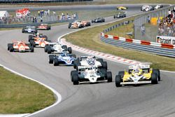 René Arnoux, Renault RE30 leads Alan Jones, Williams FW07C-Ford Cosworth, Nelson Piquet Brabham, BT4