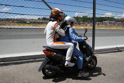 Race retiree Stoffel Vandoorne, McLaren on a scooter