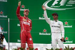 Podium: second place Sebastian Vettel, Ferrari, and Race winner Lewis Hamilton, Mercedes AMG, on the