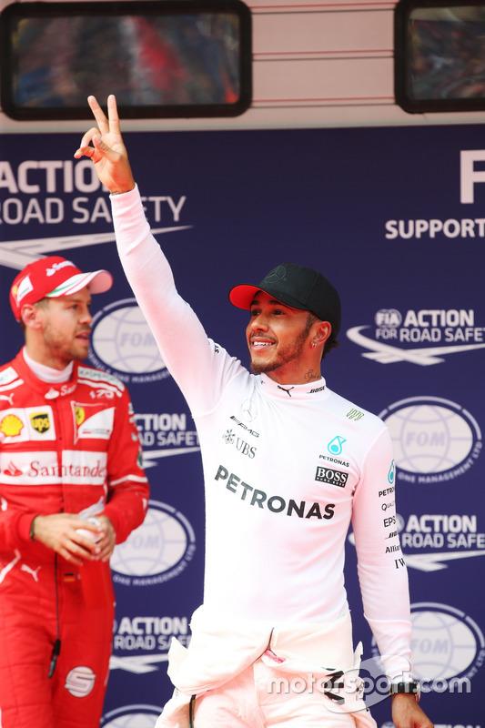 Lewis Hamilton, Mercedes AMG, celebrates pole position ahead of Sebastian Vettel, Ferrari
