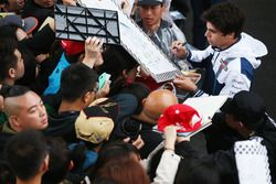 Lance Stroll, Williams, signs autographs for fans