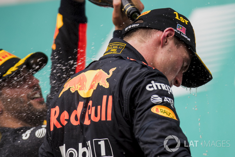 third place Daniel Ricciardo, Red Bull Racing, pours Champagne down the back of Max Verstappen, Red Bull Racing, race winner, on the podium