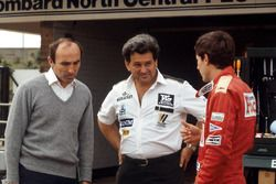 Ayrton Senna, discusses his first run in the Williams FW08C with team owner Frank Williams and Allan