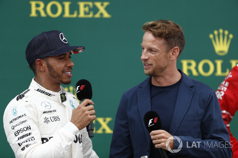 Race winner Lewis Hamilton, Mercedes AMG F1, is interviewed by Jenson Button, McLaren, on the podium