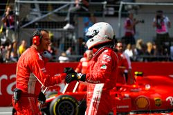 Sebastian Vettel, Ferrari, is congratulated on his third place finish