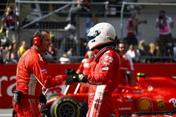Sebastian Vettel, Ferrari, is congratulated on his third place finish