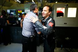Guenther Steiner, Team Principal, Haas F1, and a Haas F1 engineer celebrate the team's best finish to date